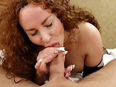 Red-haired expert deep-throats a big cock and splashes blink