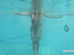 Lucy Gurchenko Takes off her absorbs suit in swimming pool