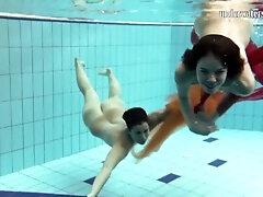 2 cuties sunk underwater